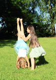 Girls training handstand Royalty Free Stock Image