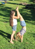 Girls training handstand Stock Photo