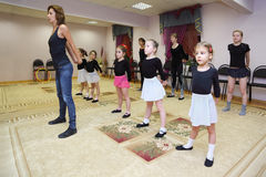 Girls trains with ballet teacher stock photo