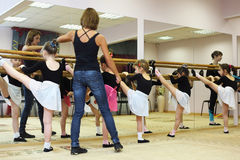 Girls trains with ballet teacher Royalty Free Stock Photo