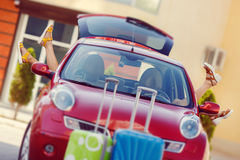 Girls - travelers relaxing in the car Royalty Free Stock Images