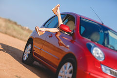 Girls - travelers relaxing in the car Stock Image