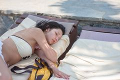 Girls traveling on a yacht are tired and fell asleep on the stern. royalty free stock image
