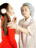 Girls treat sore throat Stock Images