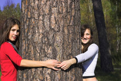Girls and tree Royalty Free Stock Photo