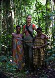 Girls from tribe Baka with the white woman. Africa. Jungle of the Central-African Republic. On November, 2nd, 2008. Girls from tribe Baka with the white woman royalty free stock photos