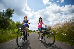 Girls on a trip riding bicycles Royalty Free Stock Images