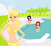 girls and tropical pool Royalty Free Stock Photos