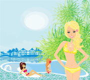 Girls and tropical pool Royalty Free Stock Images