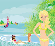 Girls and tropical pool Stock Images