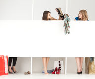 Girls trying clothes store wordrobe Royalty Free Stock Photo