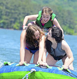 Girls Tubing Behind a Boat Stock Photo