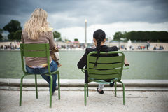 Girls in Tuileries garden in Paris Royalty Free Stock Photography