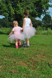 Girls in Tutus. Color photograph of two girls wearing tutus Royalty Free Stock Images