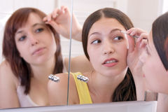 Girls with tweezers Royalty Free Stock Images