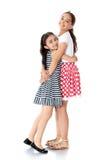 Girls twins hug Stock Images