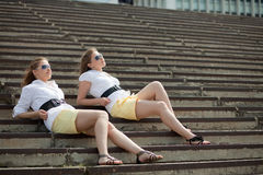 Girls are twins on the steps Royalty Free Stock Image