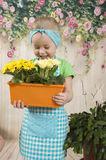Girls twins of three years care for flowers, Royalty Free Stock Photo
