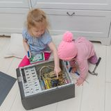 Two children repair a computer, a system unit. Girls, two children repair the computer system unit with a screwdriver Royalty Free Stock Photos