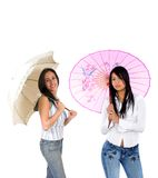 Girls with umbrellas Stock Images
