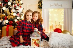 Girls under Christmas tree stock image