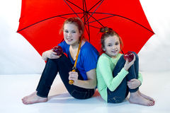 Girls Under Red Umbrella stock photo