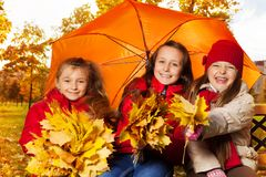 Girls under umbrella Royalty Free Stock Image
