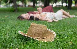 Girls unfocused relax in summer park, young hippie friends leisure royalty free stock image