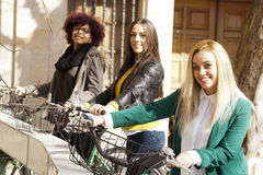 Girls with urban bikes Royalty Free Stock Photos