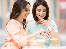 Girls in urban cafe Royalty Free Stock Image