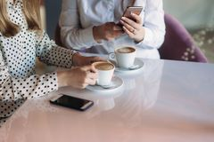Girls use their break from work to drink coffee and chat.  stock photos