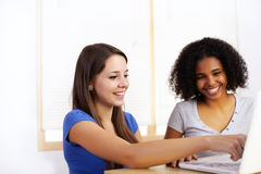 Girls using a laptop Royalty Free Stock Image