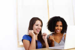 Girls using a laptop Royalty Free Stock Image