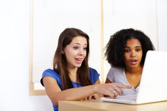 Girls using a laptop Stock Image