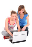 Girls using laptop Stock Photos