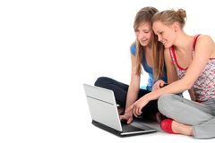 Girls using laptop Stock Images