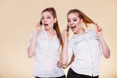 Girls using mobile phone talking. Technology and communication. Lovely teen girls using mobile phones talking, Human emotion, reaction and relationship Royalty Free Stock Photo