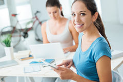 Girls using new technologies at home Royalty Free Stock Photos