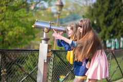 Girls using telescope for sightseeing in Paris Royalty Free Stock Photography