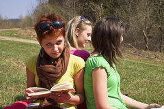 girls on vacation holiday on meadow Royalty Free Stock Photography