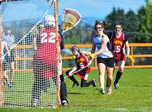 Girls Varsity Lacrosse shot on goal Stock Image