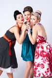 Girls in a vintage dress with microphone. Girls sing of song together Royalty Free Stock Image