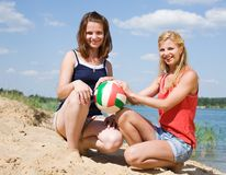 Girls with volleyball on  beach Stock Photos