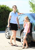 Girls waiting by a car Stock Photos