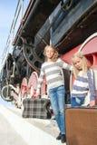 Girls waiting for landing on the platform in Stock Image