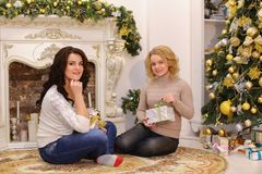Girls are waiting for pleasant New Year surprises and are sittin royalty free stock image