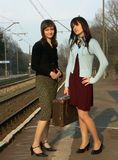 Girls waiting for the train Royalty Free Stock Photo