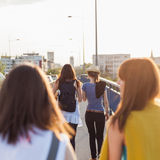 Girls walking across the bridge Royalty Free Stock Photography