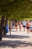Girls walking along the seaboard Stock Image