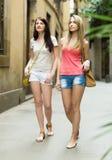 Girls  walking through ancient European city Stock Image